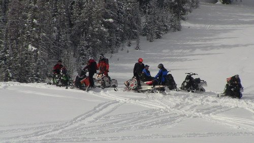 Group of 2012 snowmobiles in West Yellowstone.