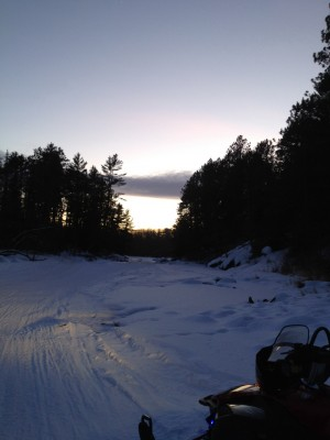 Sunset on river while snowmobiling