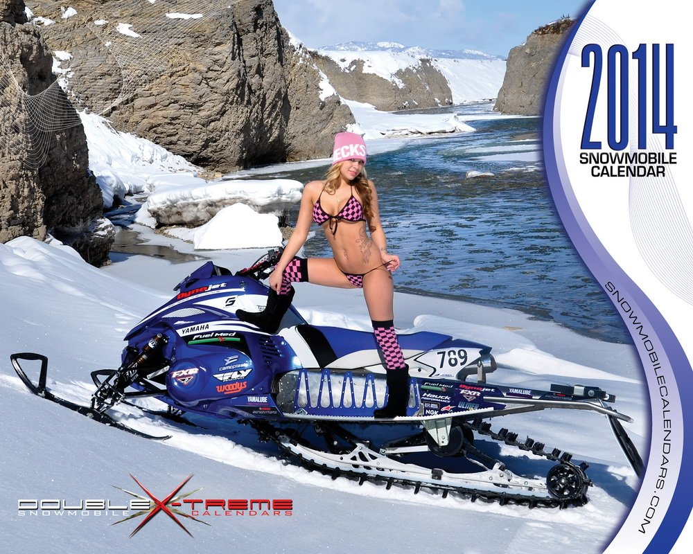 Chick in a bikini on a snowmobile