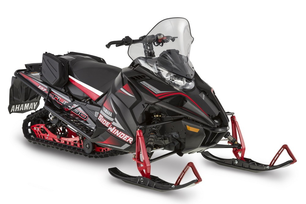 Sidewinder S-TX DX with tall windshield, large rear bag, and removable saddle bags.